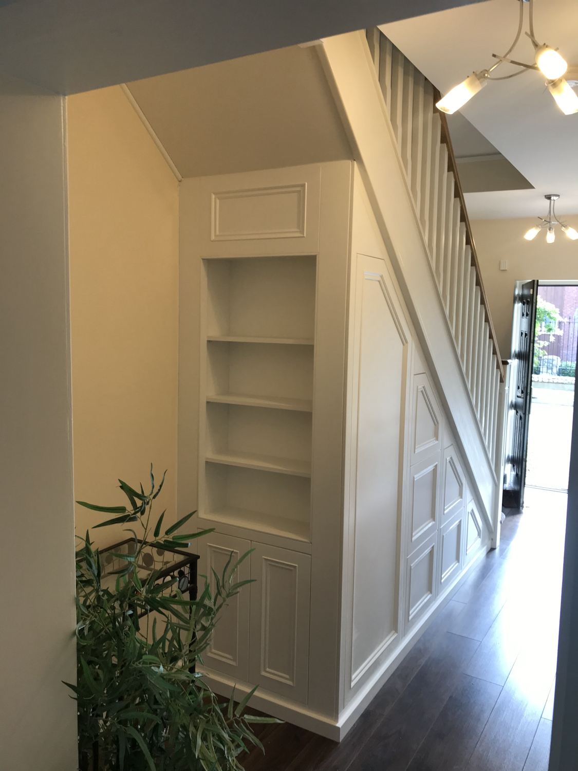 Large six drawer unit with door and slide out coat rack along with a bookcase on the end