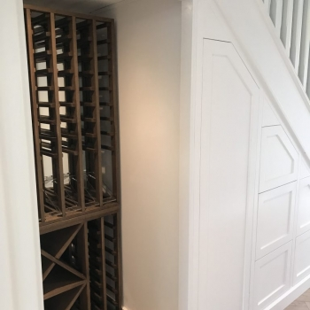 Six drawer and coat unit with space for a large wine rack
