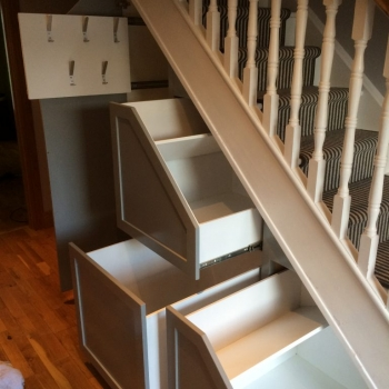 Three drawer with coat rack with white insides