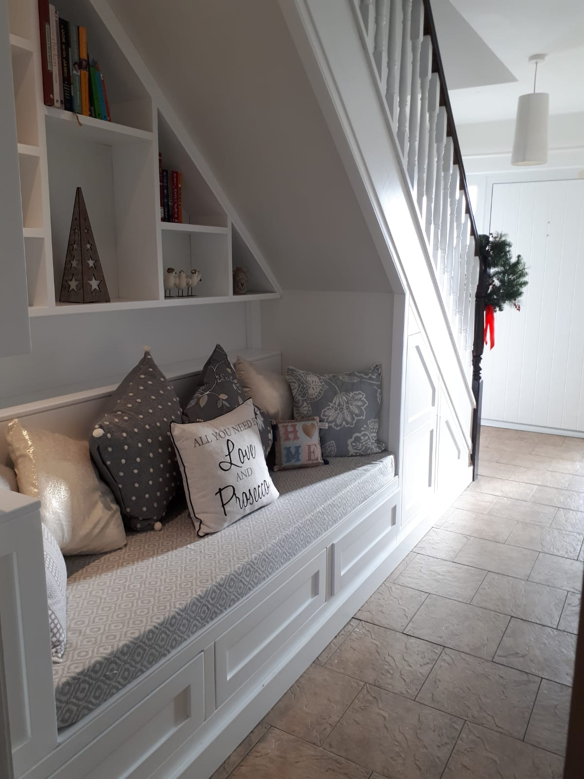 Six drawers and bookcase on the wall